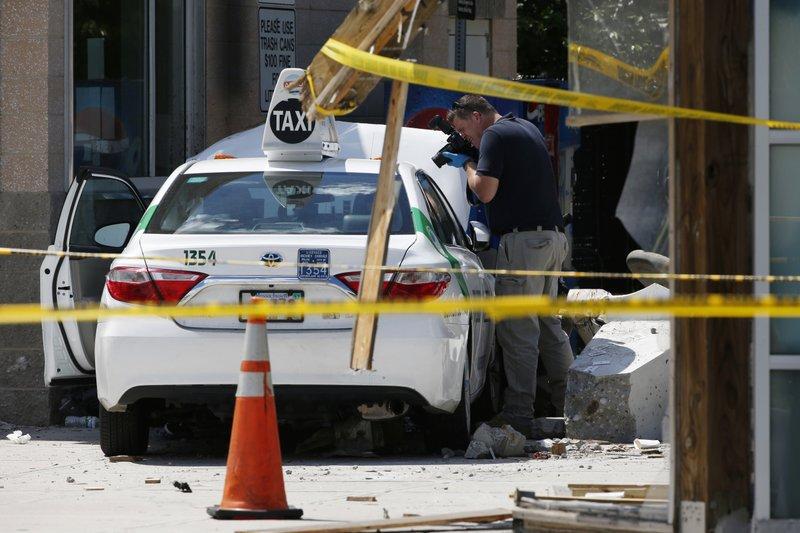 Taxi jumps curb at Boston airport, injuring 10 cabbies