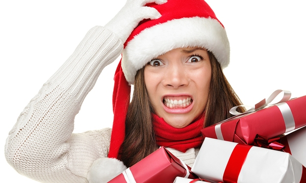 Christmas stress - busy woman wearing santa hat stressing for ch_524665