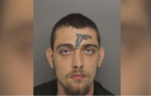 man with gun forehead_1529459167395.JPG.jpg