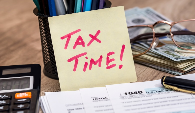 tax form with calculator, money and pen_333751
