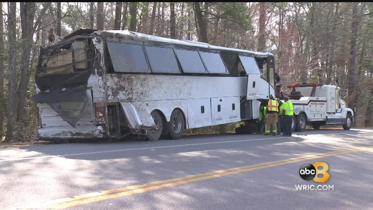 One of the passengers hurt in the deadly charter bus crash off Interstate 95 in Prince George County filed a lawsuit on Wednesday seeking more than $10 million in damages.