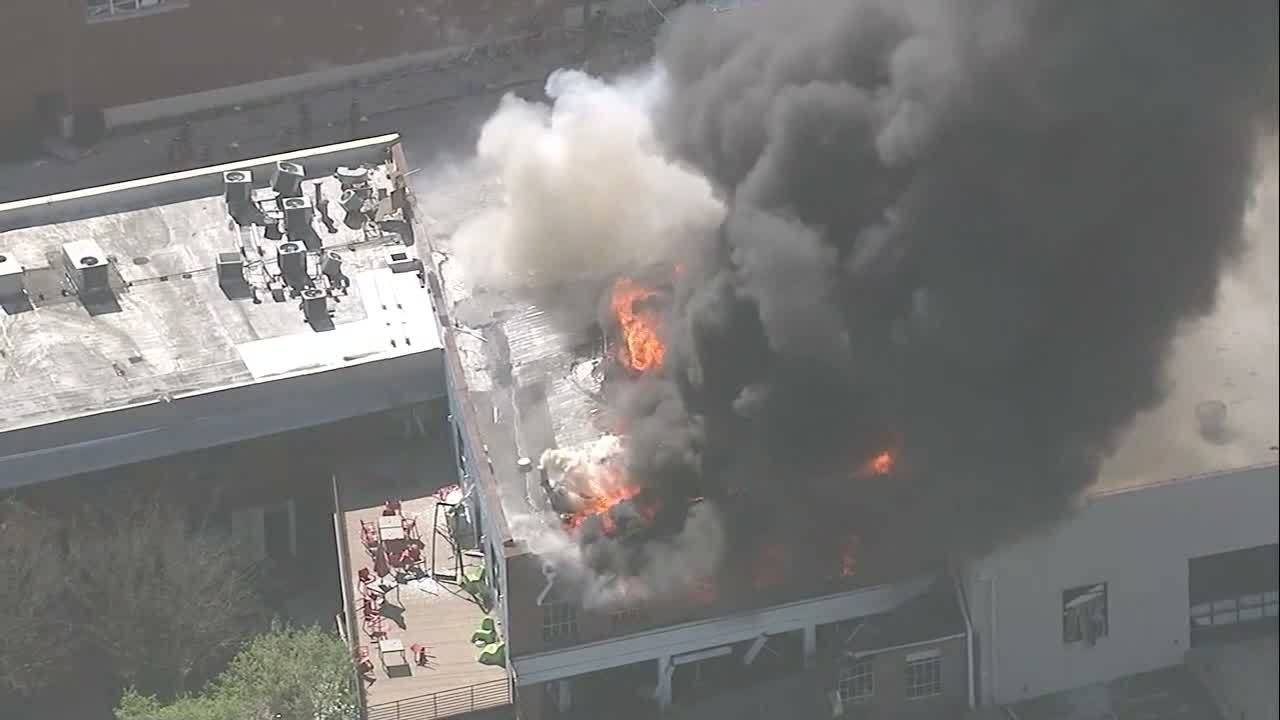 Authorities say emergency officials are responding to an explosion and fire possibly caused by a gas leak in downtown Durham, North Carolina.