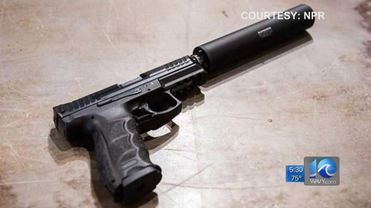 gun with supressor_1559610100704.jpg.jpg