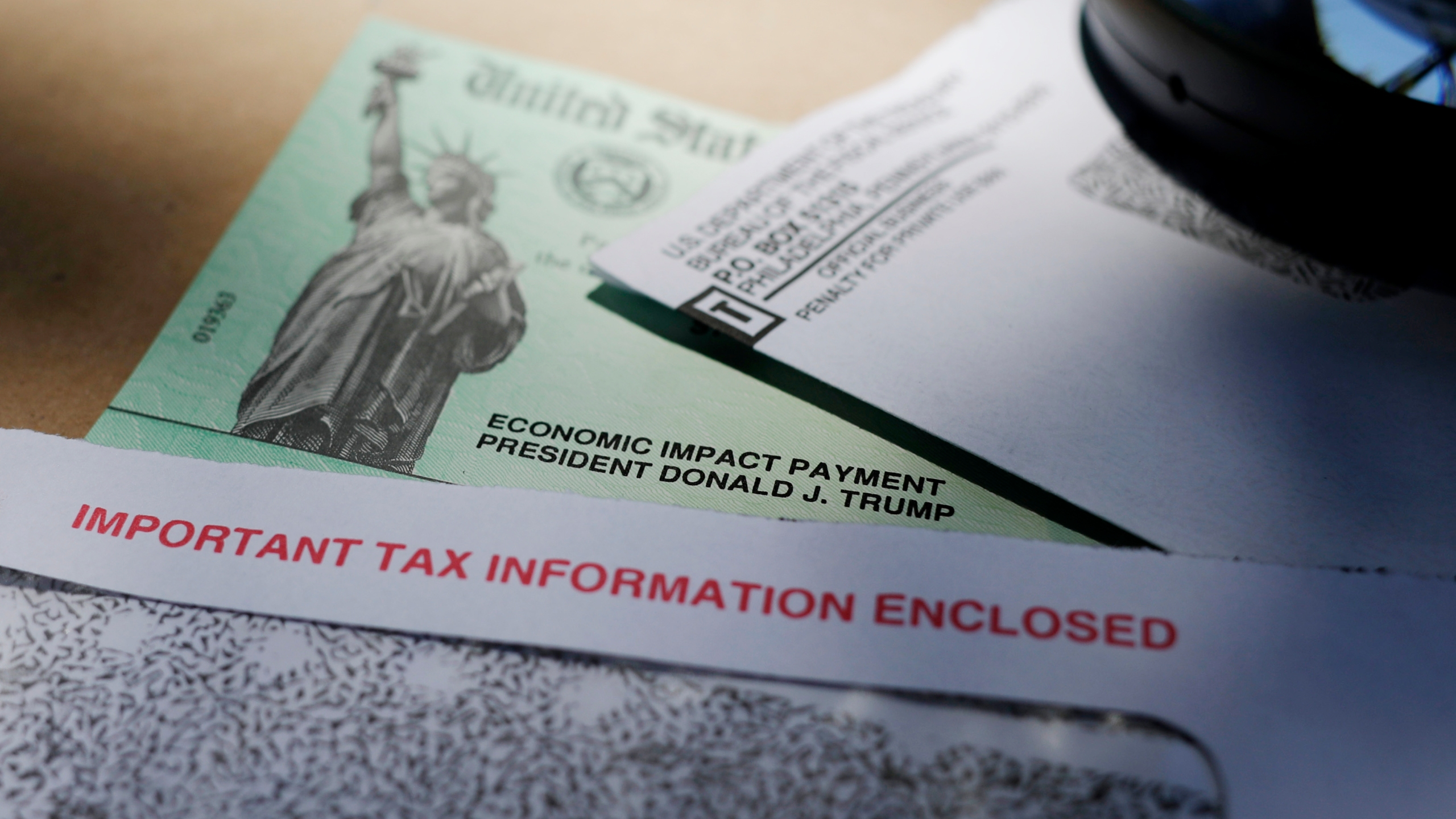 In this April 23, 2020, photo, President Donald Trump's name is seen on a stimulus check issued by the IRS to help combat the adverse economic effects of the COVID-19 outbreak. (AP Photo/Eric Gay)