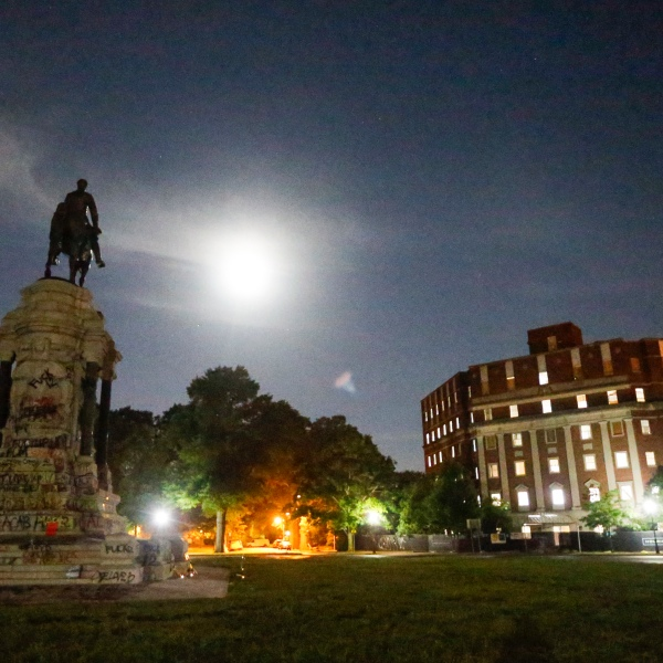 The Moon illuminates the statue of Confederate General Robert E. Lee on Monument Avenue