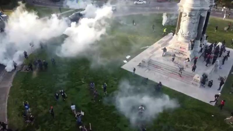 Demonstrators in Richmond being tear-gassed