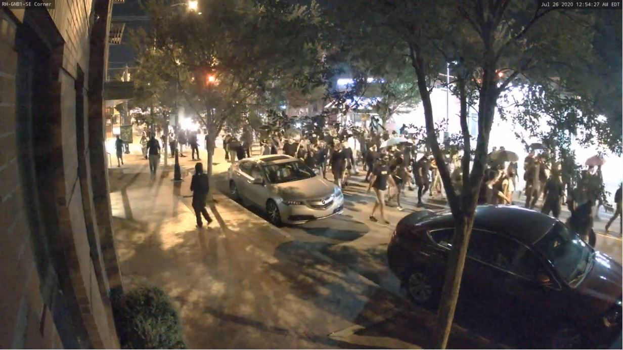A screen grab from surveillance video of protesters-turned-rioters marching down near VCU's Grace and Broad Residence Center on July 26, 2020.