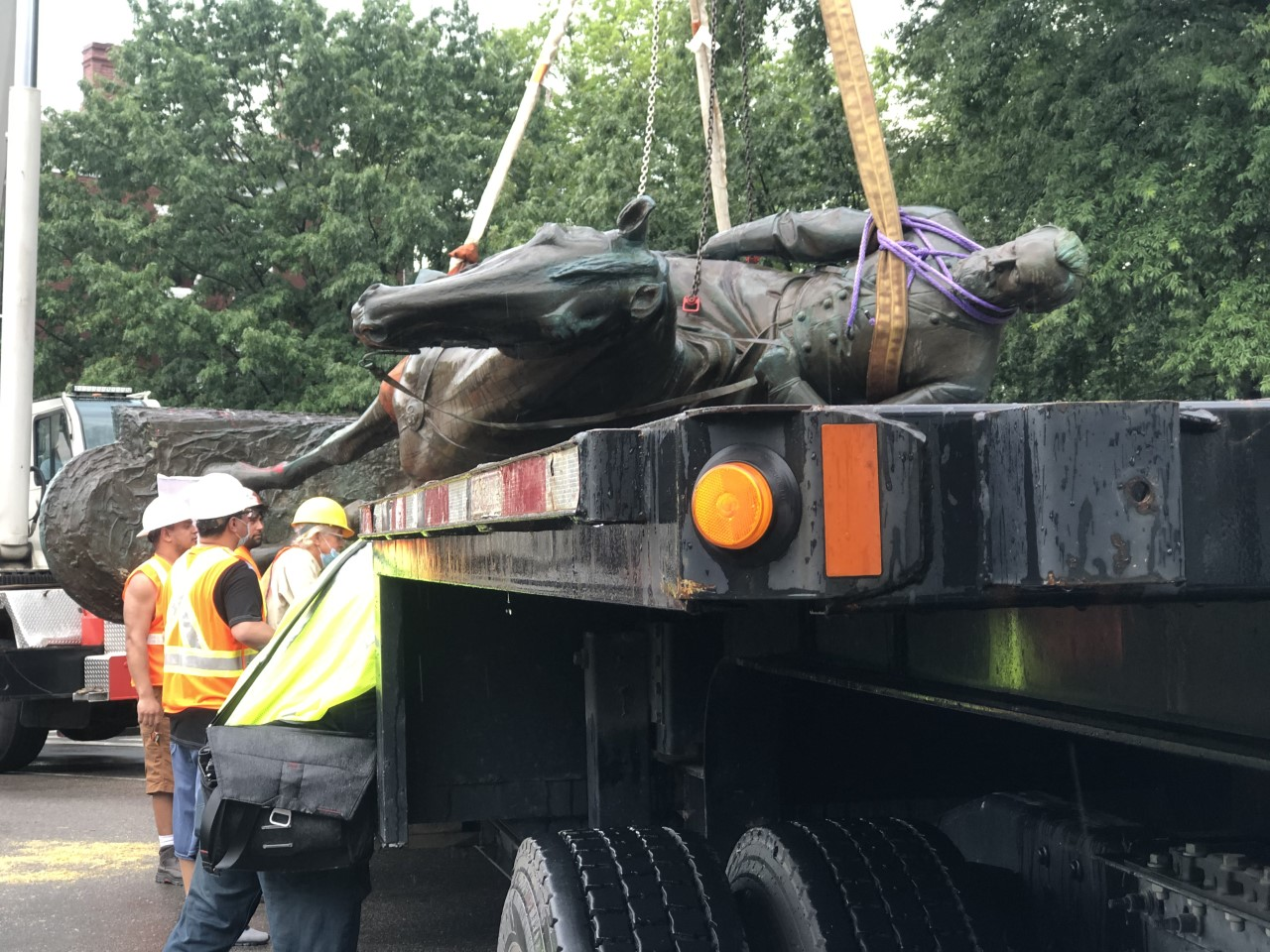 Stonewall being lifted onto flatbed