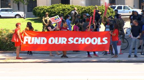 Protesters at the Fund Our Schools rally