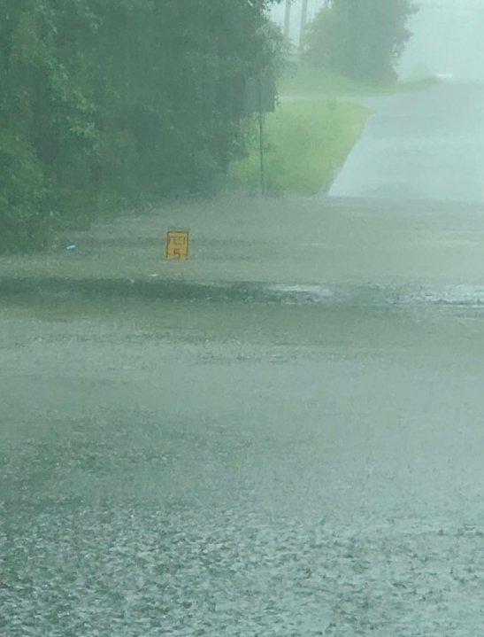 Flooding on Old Bermuda Hundred Road at Ramblewood Road