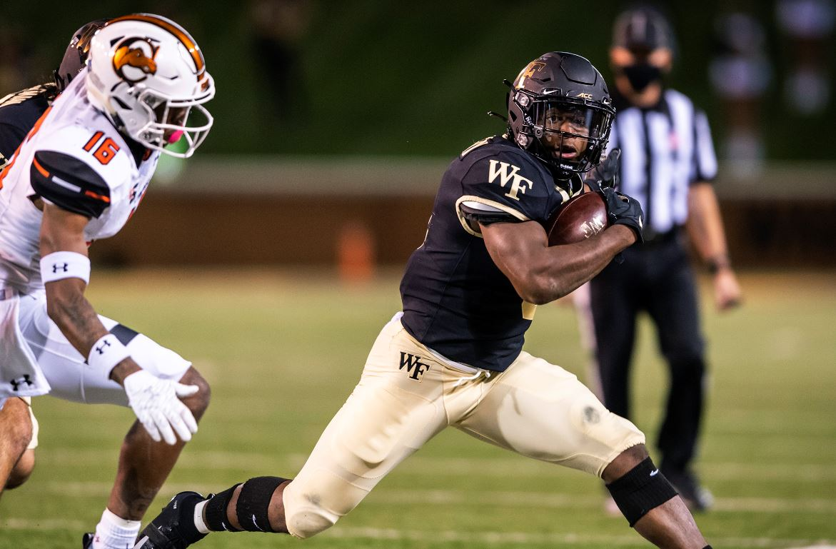 Walker runs for 3 TDs as Wake Forest beats Virginia 40-23