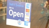 Small Business Saturday sign hangs on the door of Trend's Henrico location
