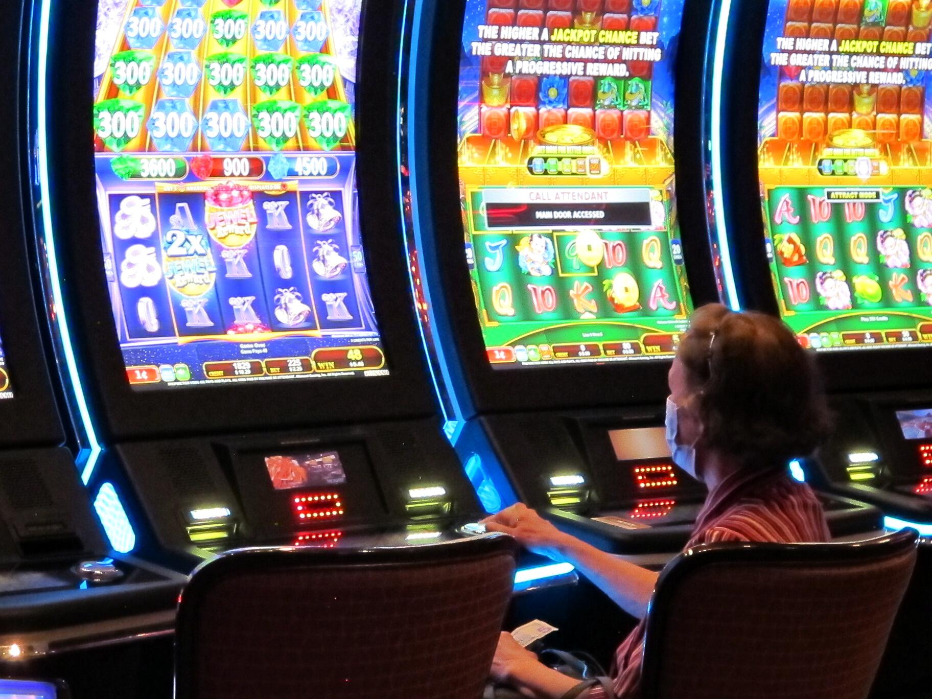 A woman plays a slot machine (AP Photo/Wayne Parry)
