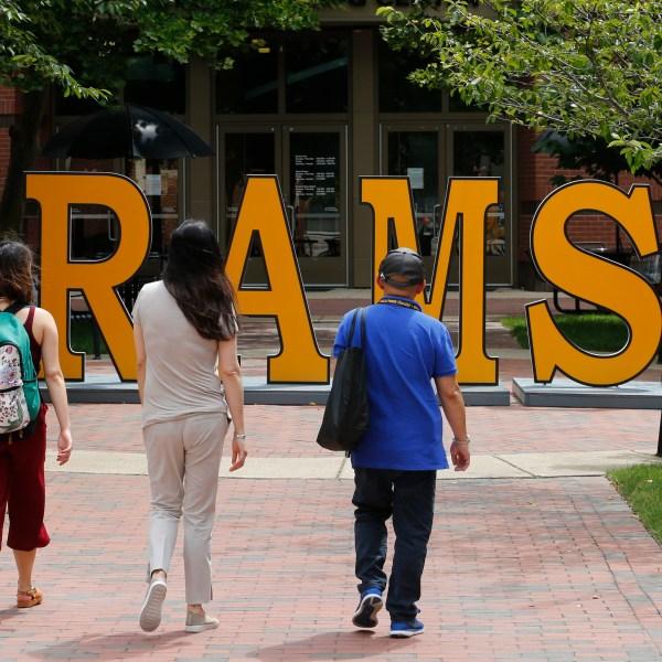 Students walk around a RAMS sign at Virginia Commonwealth University in Richmond, Va., on June 20, 2019. (AP Photo/Steve Helber, File)