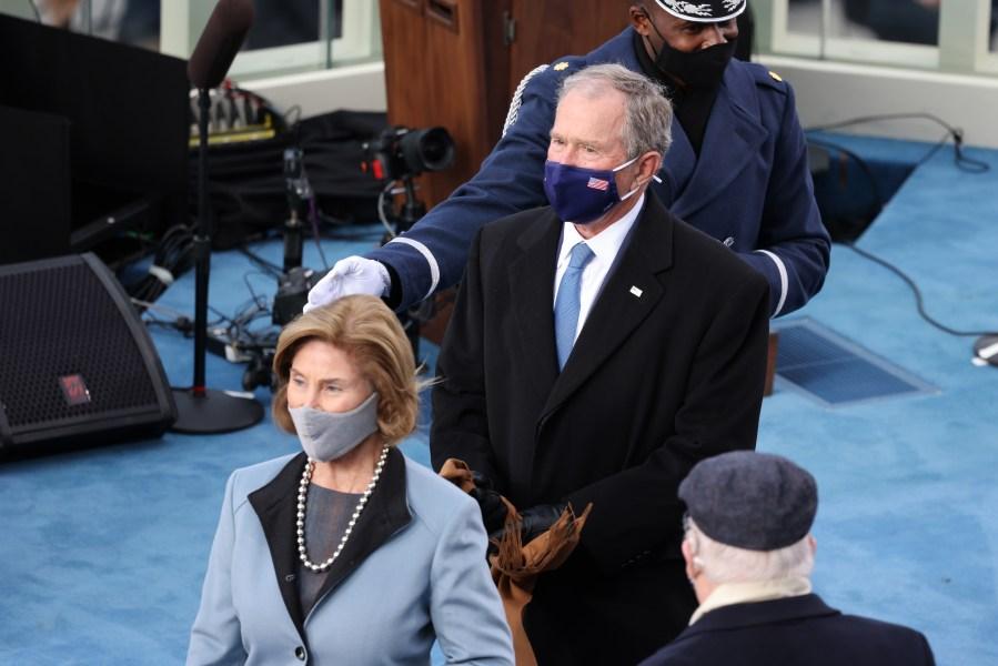 Former U.S. President George W. Bush and former First Lady Laura Bush