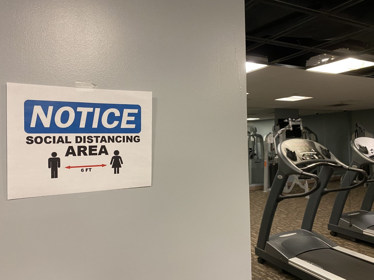 social distancing sign at gym
