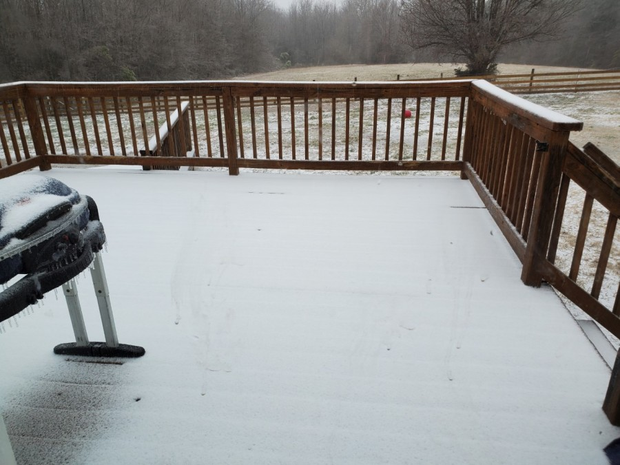 A snow dusting covering a residential deck in Powhatan.(Photo from mom2jag)