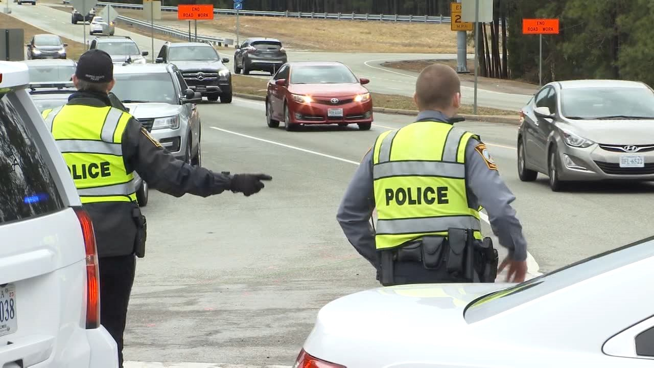 Police directing traffic while Greenwood Road is closed. (Photos by 8News' Jacob Sexton)