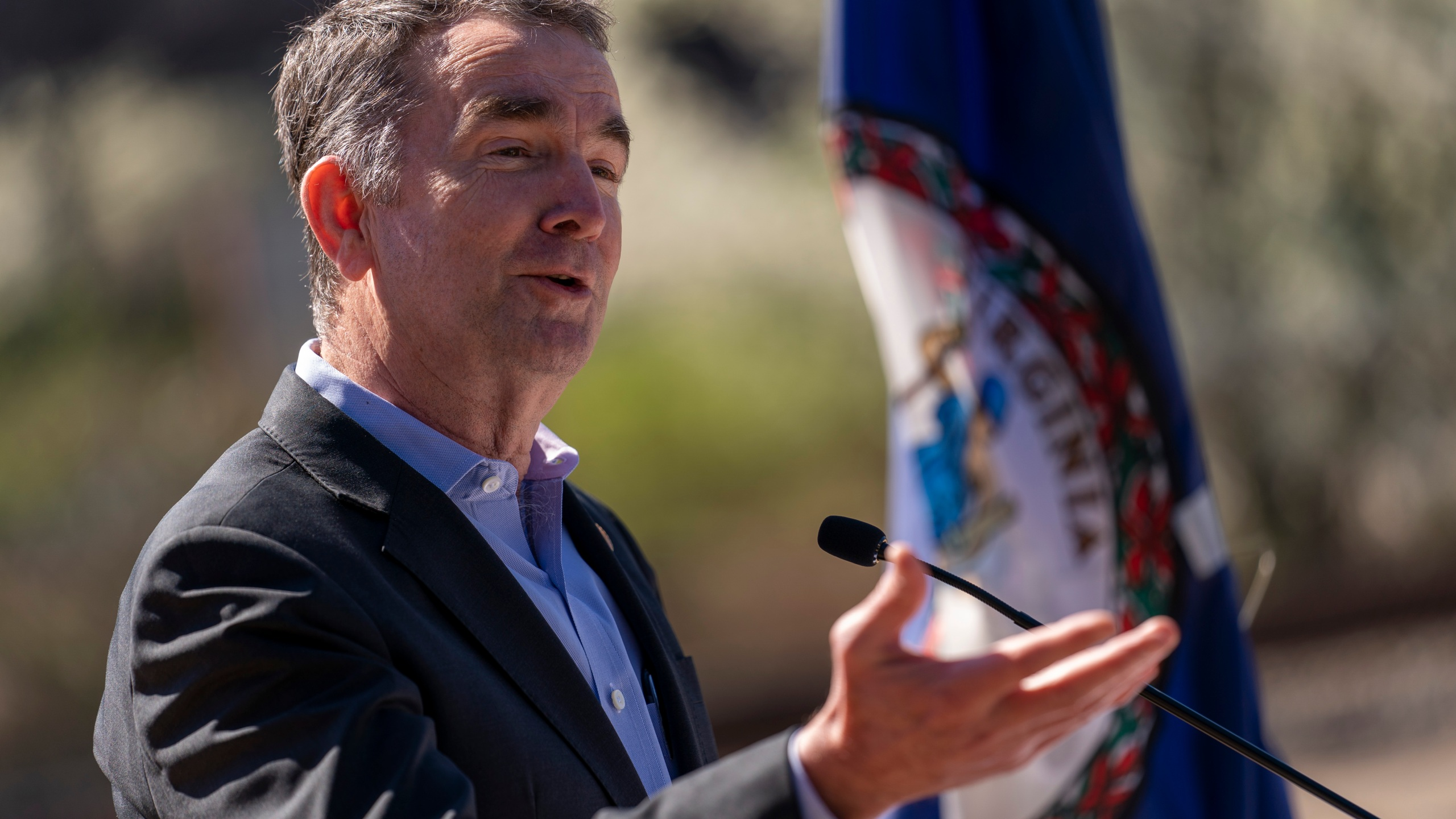 Governor Northam speaks to a crowd. (AP Photo/Andrew Harnik, File)