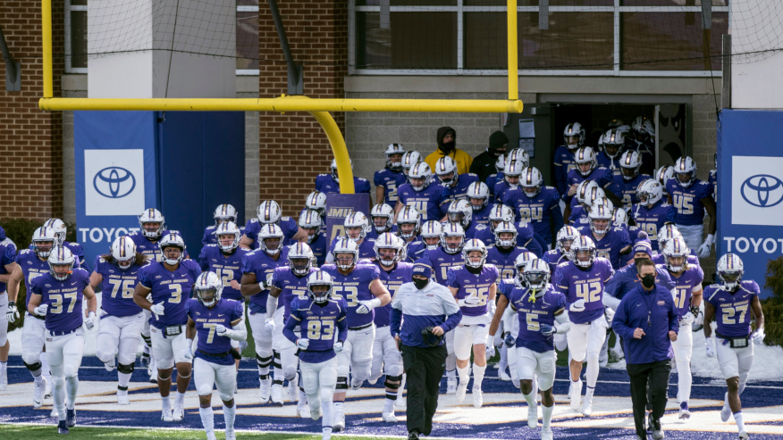 The James Madison team runs out onto the field before an NCAA college football game against Morehead State in Harrisonburg, Va. (Daniel Lin/Daily News-Record via AP, File)