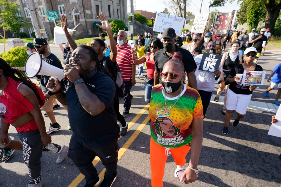Protesters march along the streets to protest the shooting of Andrew Brown Jr. in Elizabeth City, N.C.