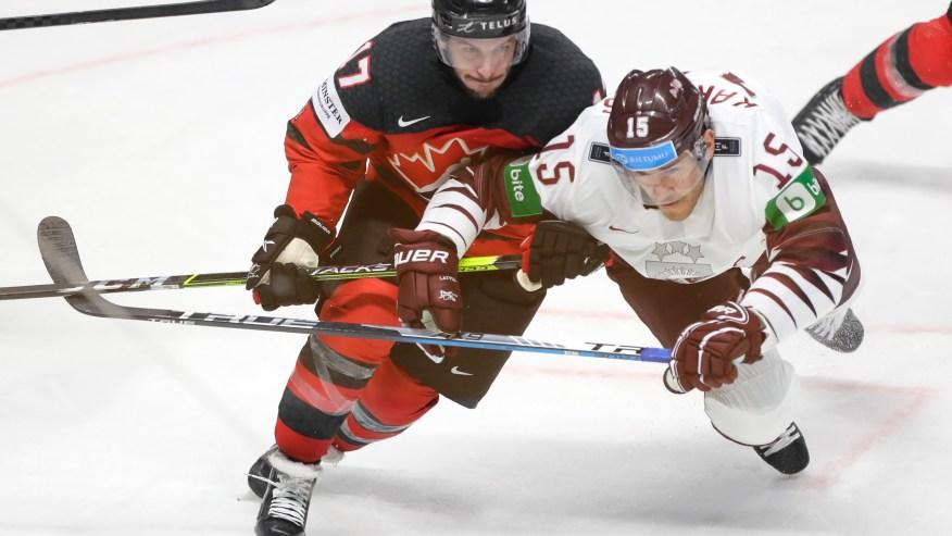 Host Latvia beats Canada 2-0 in world hockey opener | 8News