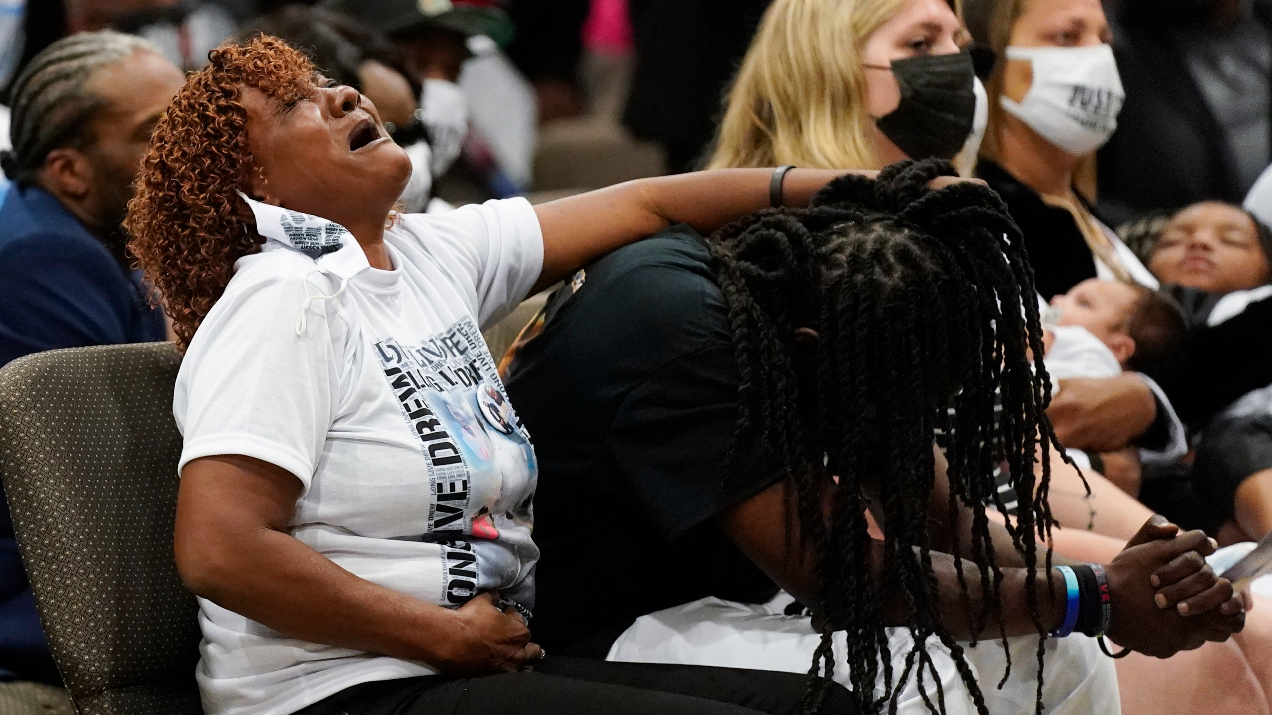 Family members react during the funeral for Andrew Brown Jr.