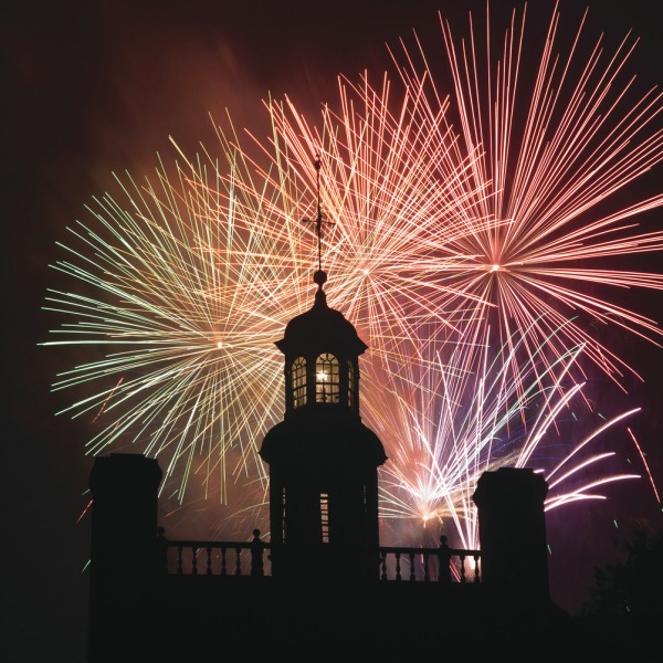 Colonial Williamsburg Governor's mansion backlit by fourth of july fireworks