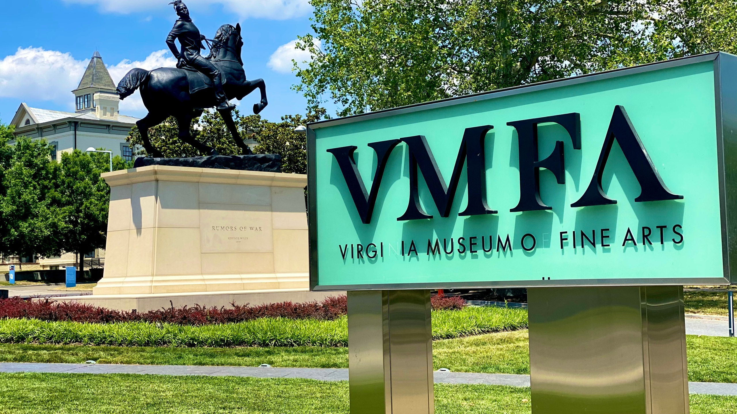 Virginina Museum of Fine Arts sign with the Rumors of War statue in the background