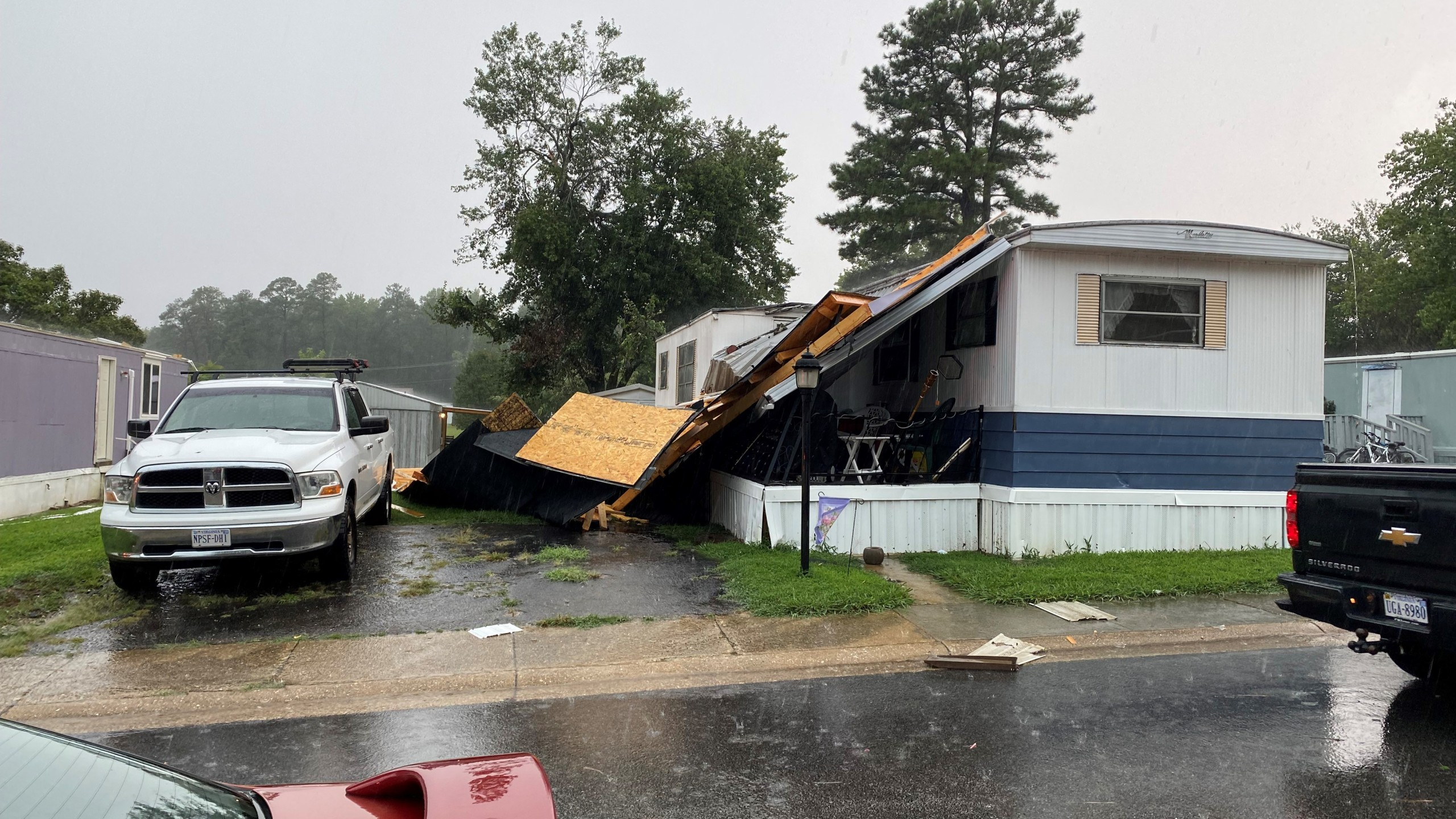 Severe weather damaged the roof on a trailer in Greenleigh Mobile Home Park in Chester, Virginia