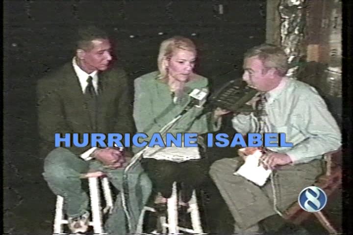 Juan Conde, Lisa Shaffner and John Bernier covering Hurricane Isabel
