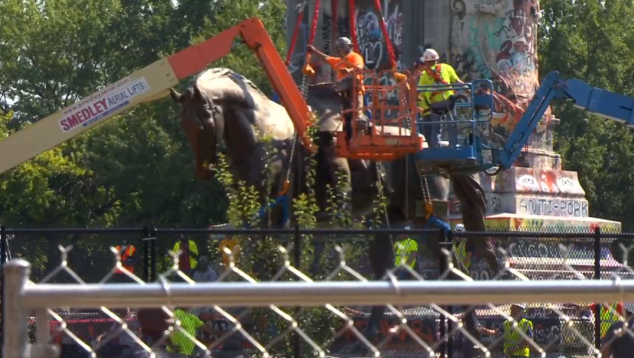 Work crews are placing straps around the rest of the statue