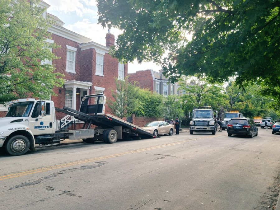 Cars being ticketed and towed on Park Avenue