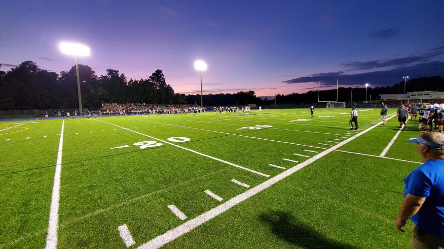 The field is bright under the Friday night lights