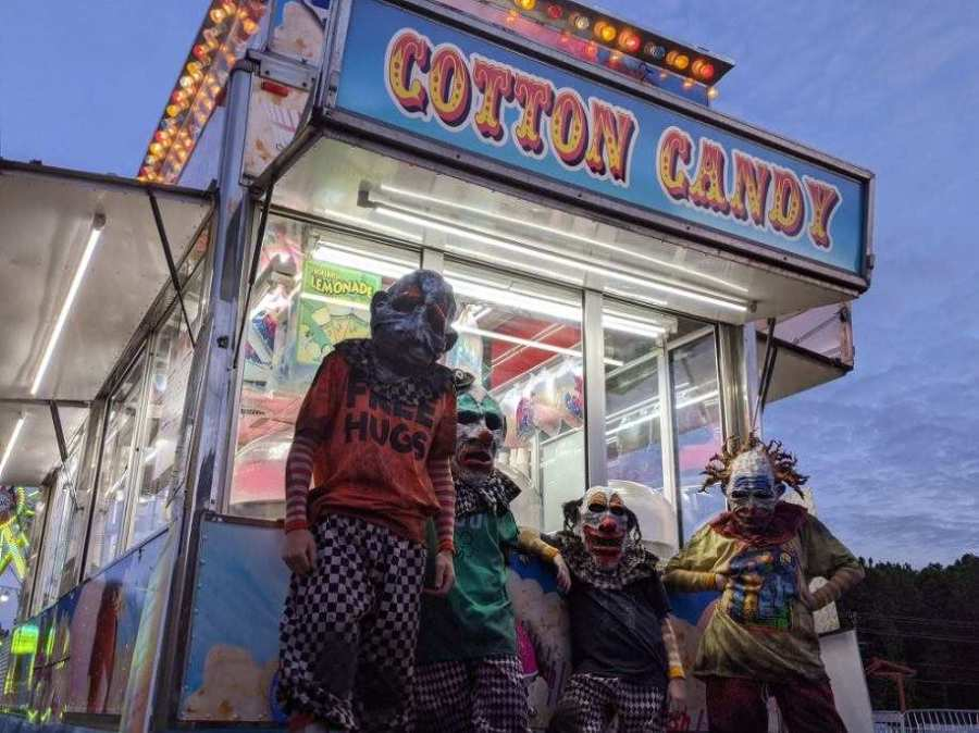 total terror characters in clown costumes haunt haunted house
