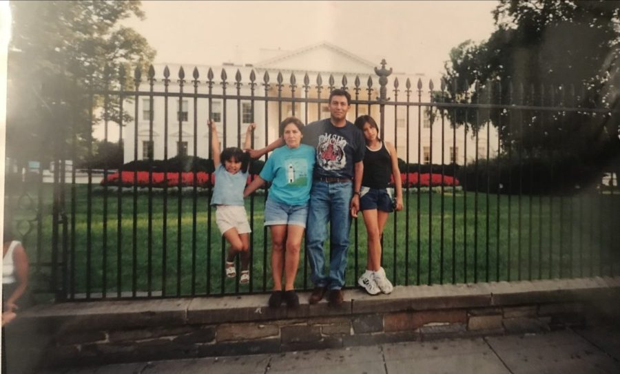 Ethel Velasquez (L) stands with her family for a family portrait in front of the White House. (Photo provided by Velasquez)